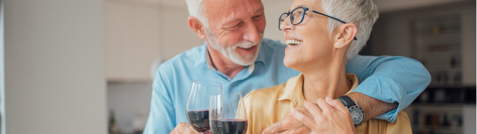 smiling-man-and-woman-holding-glasses-of-red-wine