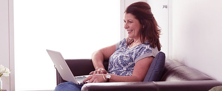 woman on couch with laptop